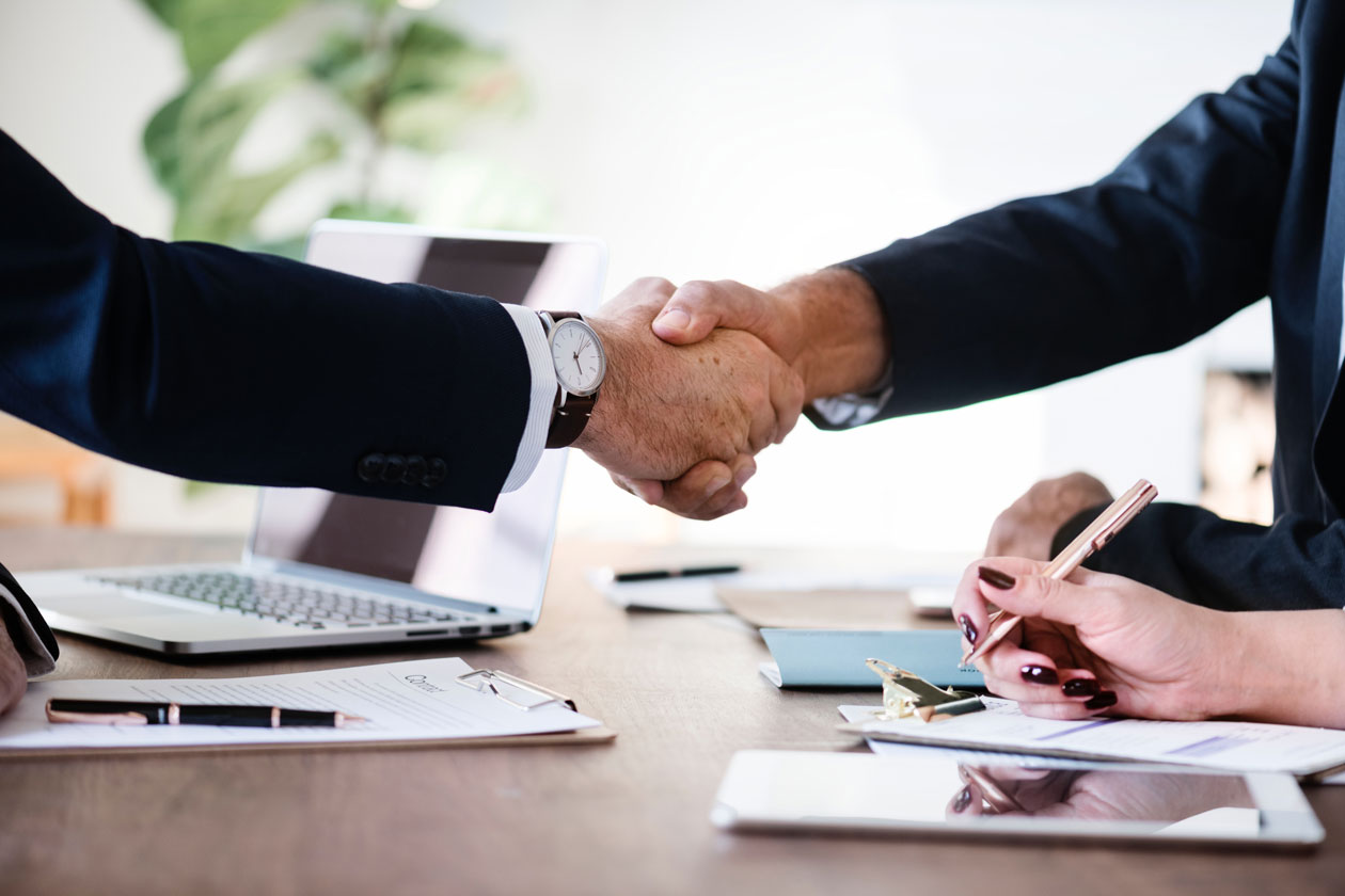 stock photo of people shaking hands