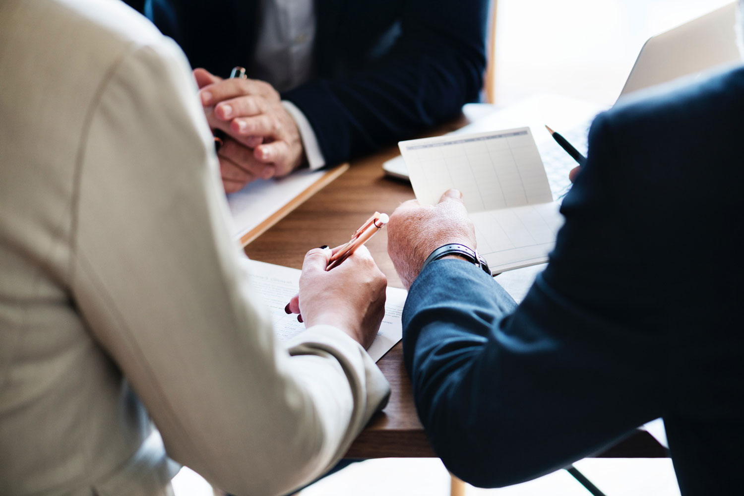 stock photo of people meeting at table