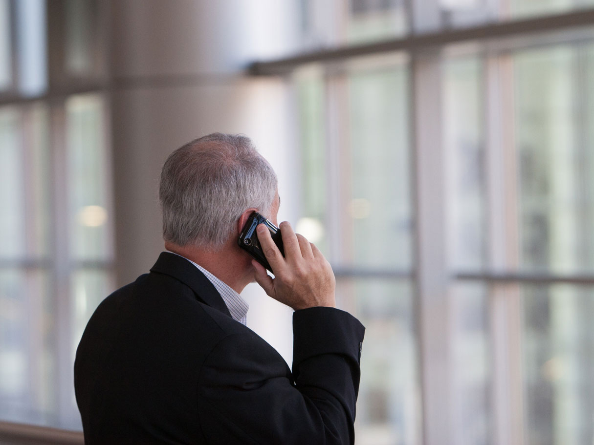 stock photo of man talking on cell phone